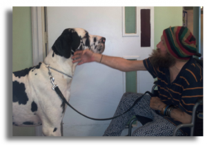 A man and a dog bonding during Equinox residential drug treatment.