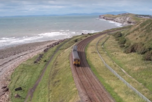 Turning Point residential drug treatment and Cumbria Rail - Showing a train by the coast