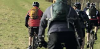 cyclists on the front cover of the DDN addiction Treatment Guide