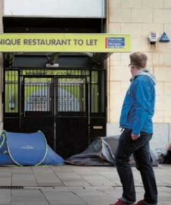 Tents used by homeless people outside an empty retail unit in Cardiff,